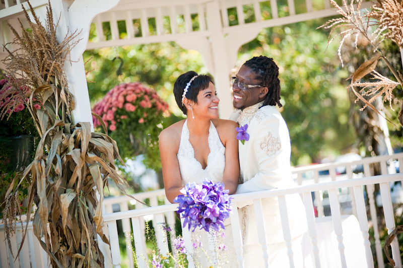 Latina bride on bridge purple flowers African-American groom