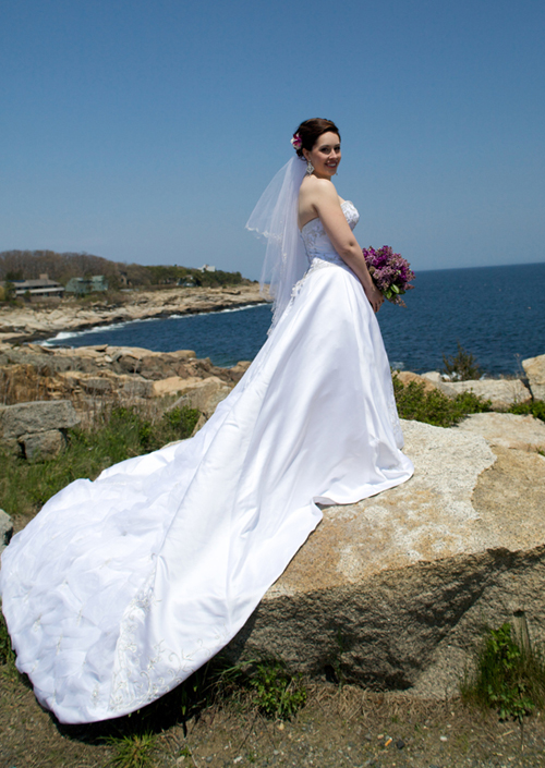 bride with full train by ocean Rockport MA wedding