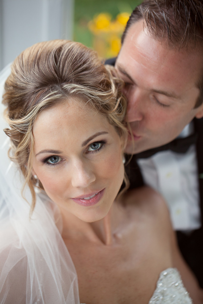 beautiful blonde bride with smoky plum eye makeup and nude pink lips