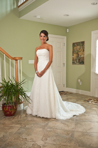 Elegant bride posing in living room