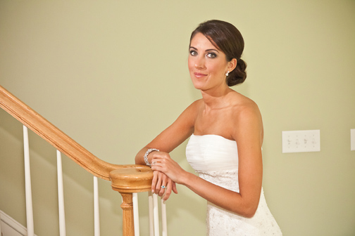 Elegant bride posing on staircase