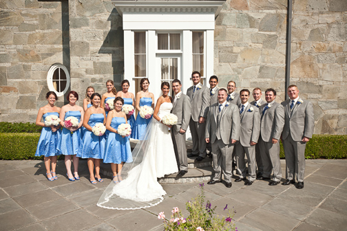 Bride, groom and their bridal party in blues and greys