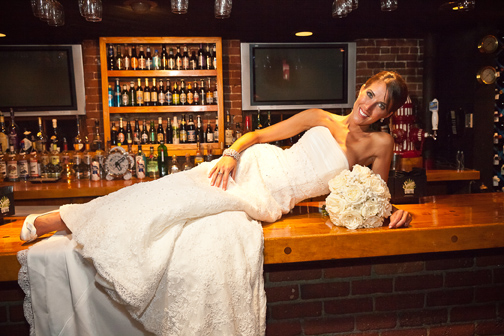 Elegant bride posing on a bar