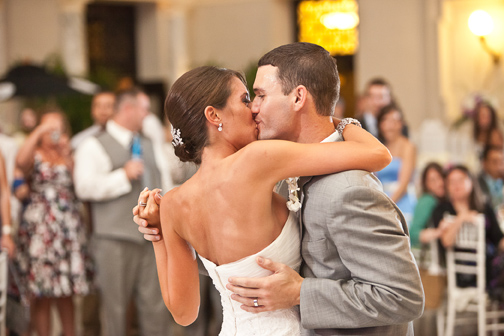 Bride & groom kiss while dancing