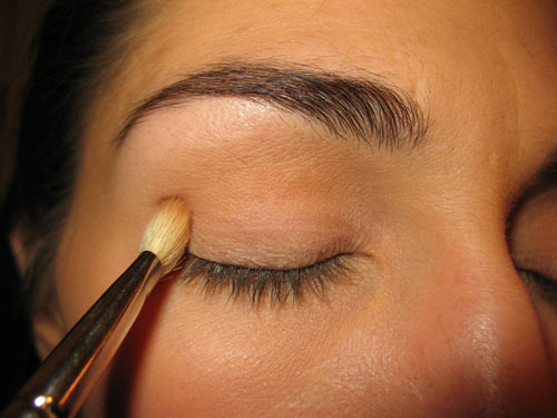 applying eyeshadow to the crease