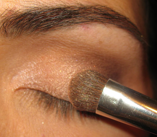 applying shimmery eyeshadow