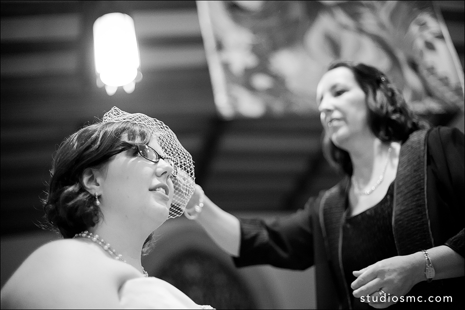 Bride and mom adjusting her birdcage veil