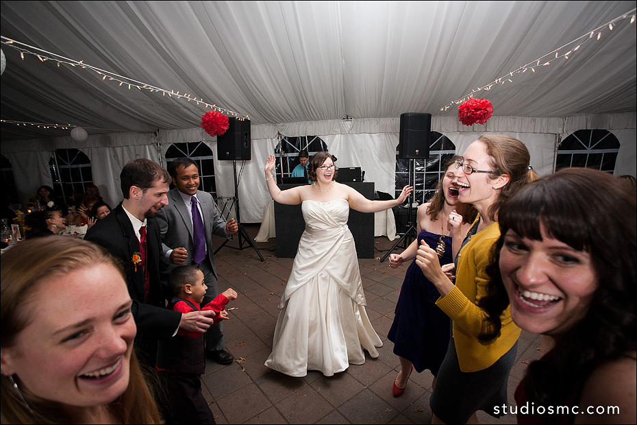 bride dancing joyfully at reception