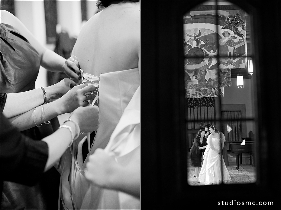 Bride getting her dress laced up before the ceremony