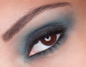 Close up of Afro-Am model's eye with teal smoky shadow