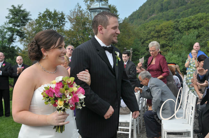 Bride and groom walk down aisle outdoor moutaintop Log Cabin ceremony