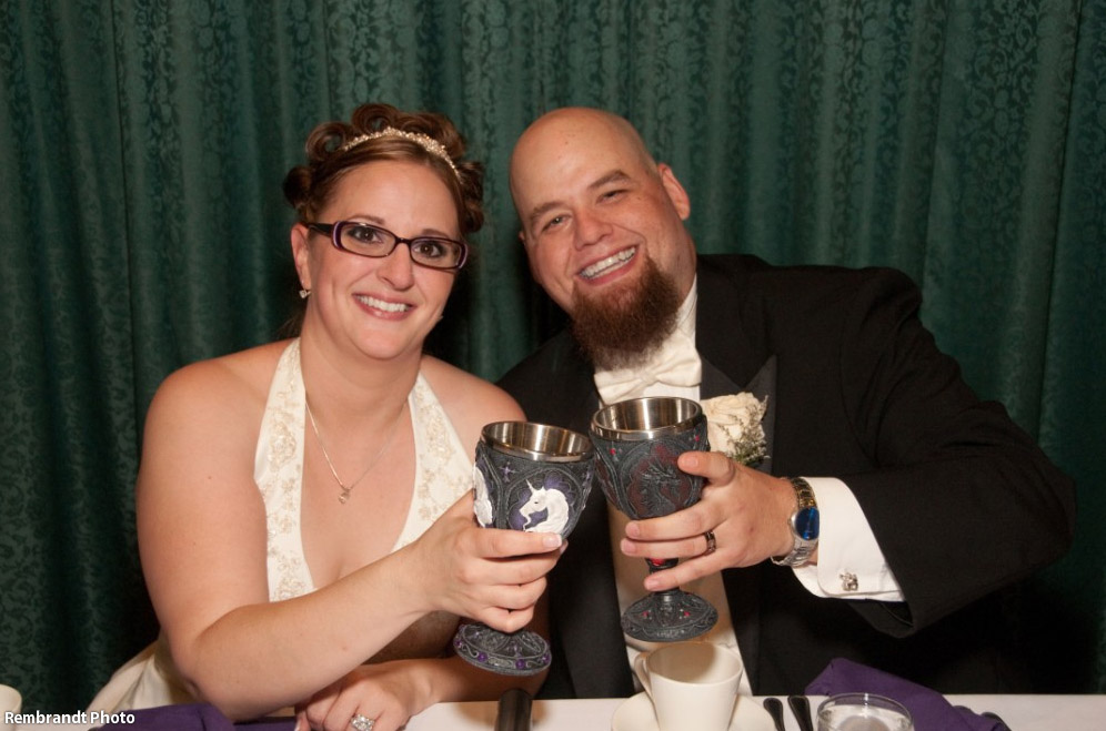 Bride and groom toasting with goblets