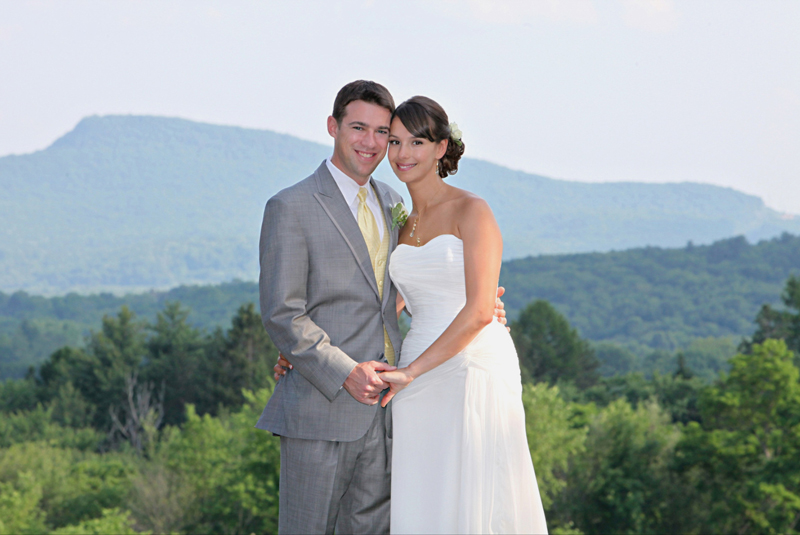 Bride and groom posed before a Western MA mountain range