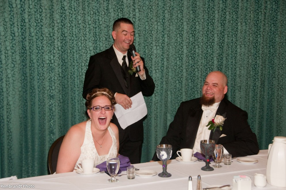 Bride laughing out loud during a toast