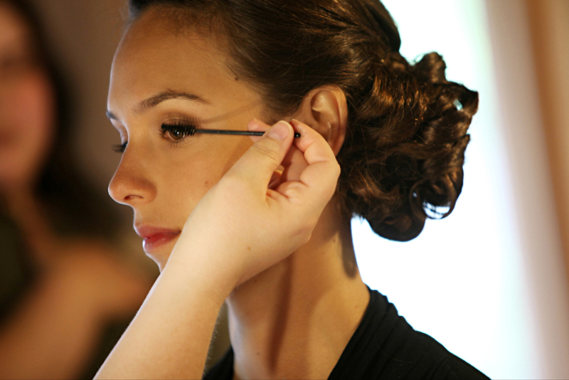 Bride getting mascara applied with a disposable wand
