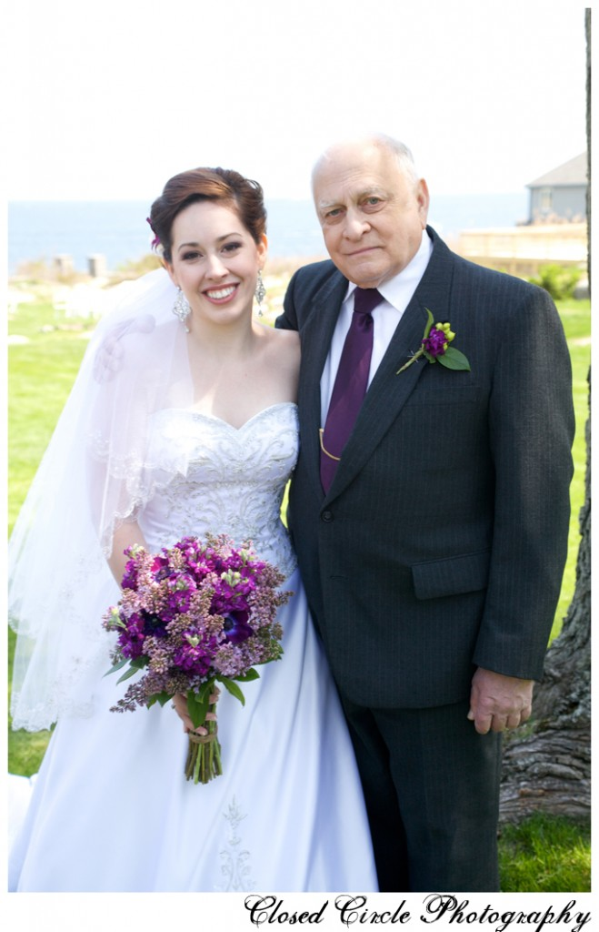 bride with relative at outdoor wedding ceremony purple bouquet
