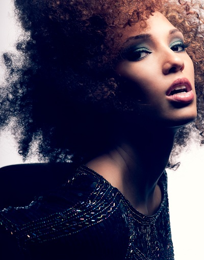 Teal and brown smoky eye on AfroAm model with natural hair