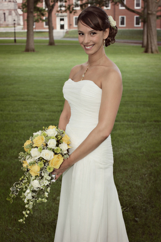 Elegant bride with yellow and white cascade bouquet