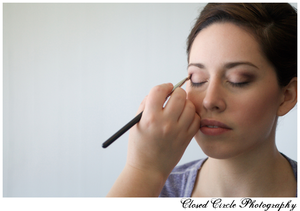 bride getting smoky contoured eyeshadow applied