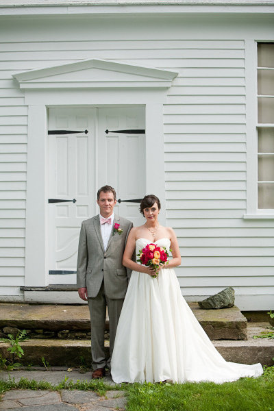 Bride & groom posing before classic Mt. Holyoke architecture