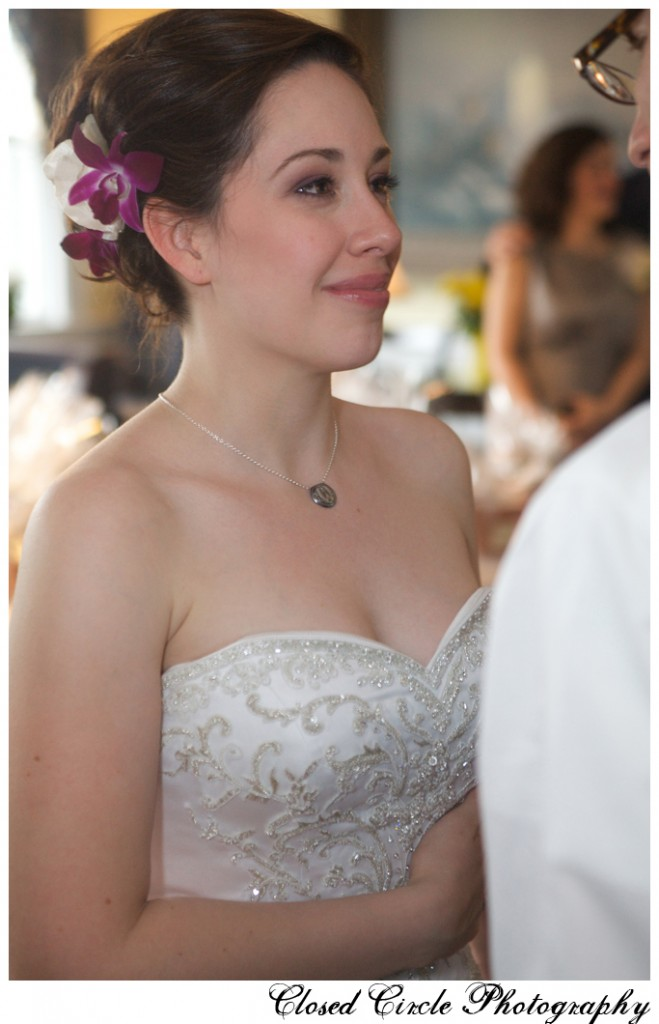Bride with violet hair flower and natural elegant makeup