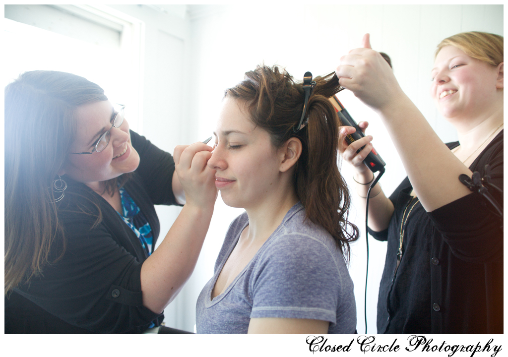 Wedding makeup artist and hairstylist working together