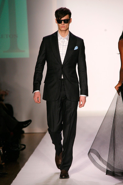 Male model walking for Malan Breton Fall 2012