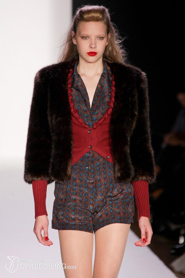 Model with smoky earthtone eyes and red lips on the NY runway for Bebe