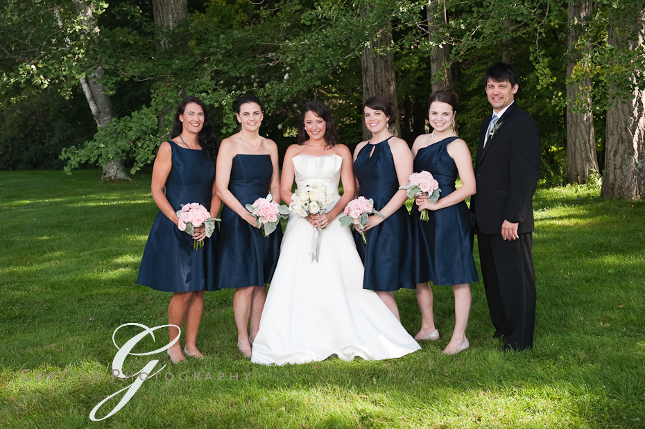 bride and bridesmaids wearing navy dresses at the Winthrop Estate