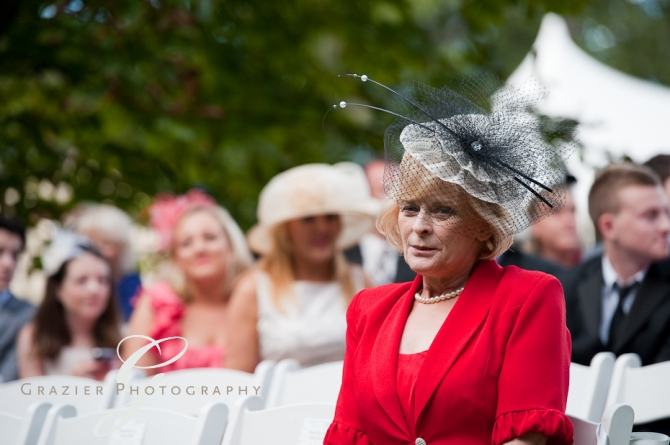 British woman wearing a festive hat at a Lenox MA wedding