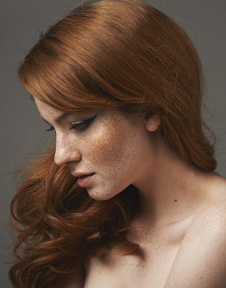 freckled redhead with winged cateye eyeliner