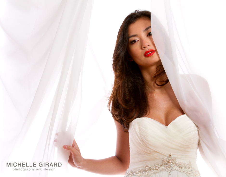 Asian bride with orange red lipstick and sweetheart neckline wedding dress