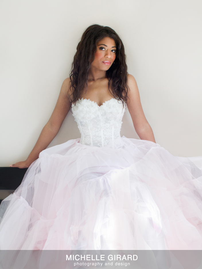 afroam model wearing feather bustier and tulle skirt