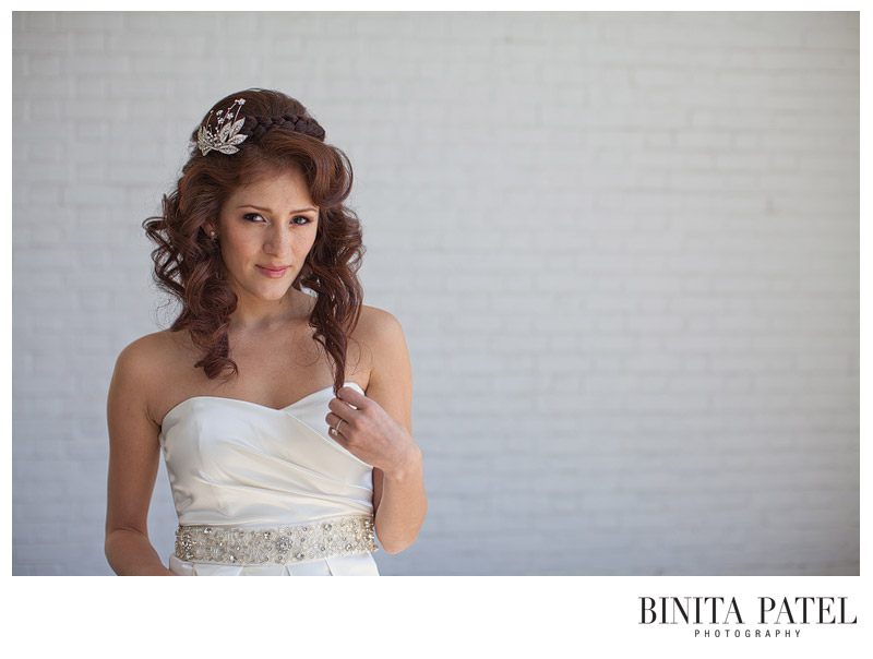 petite redheaded Latina bride with smoky eyes and curly hair