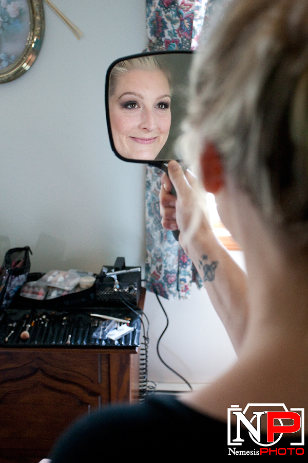 smoky eyed bride admiring self in mirror