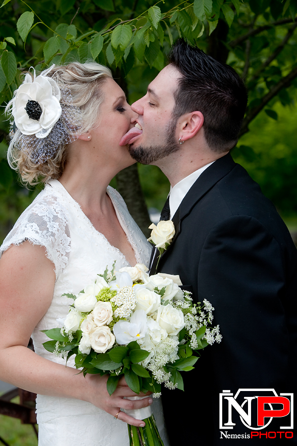 punk rock groom licking bride's face