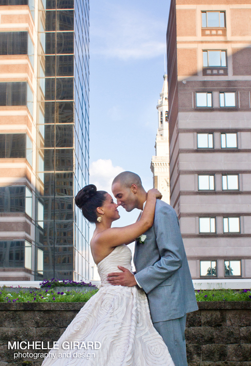 african american bride and groom on the Marriott rooftop in downtown Springfield MA