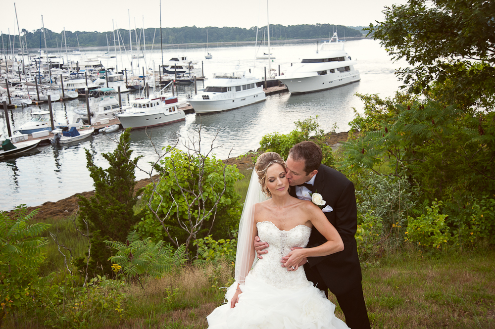 groom kissing bride by the ocean at Wentworth by the Sea