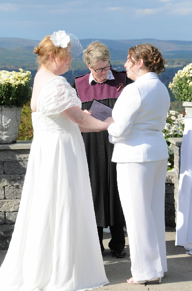 bride in dress and pantsuit same-sex wedding in western ma