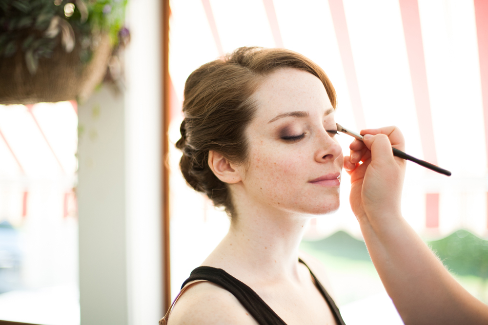 bride getting smoky eyeshadow applied