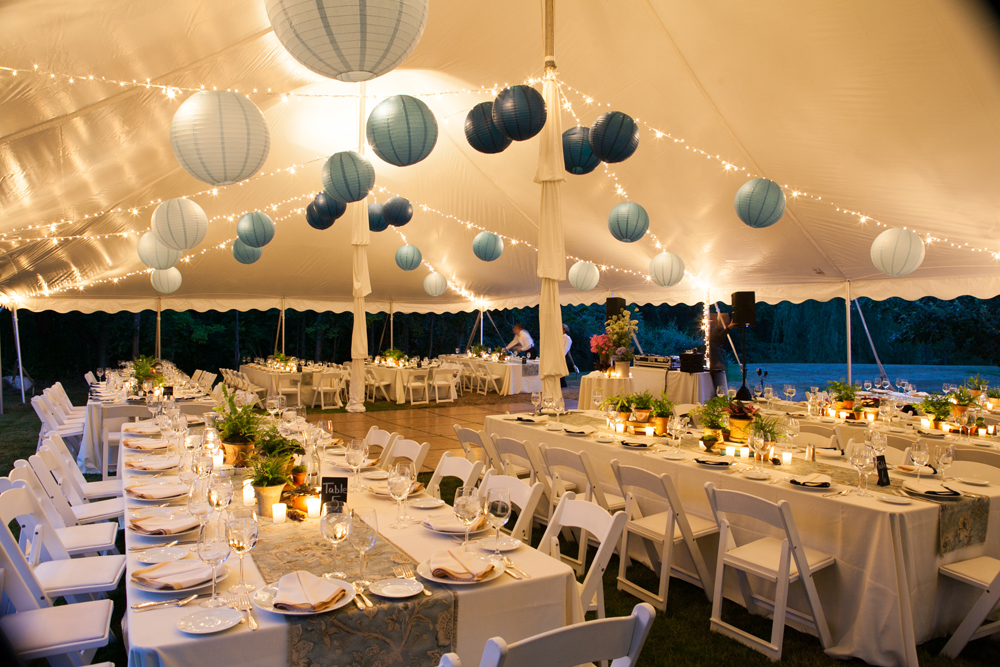 wedding reception tent decorated in blue and white