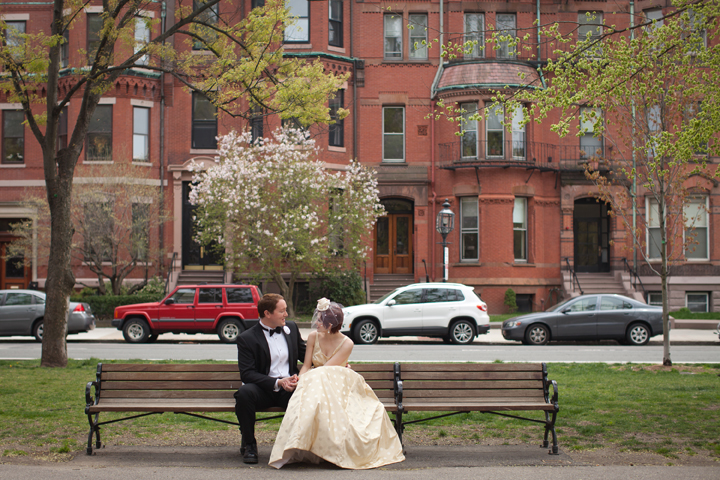 Bride and groom on a park bench on Comm Ave in Boston MA
