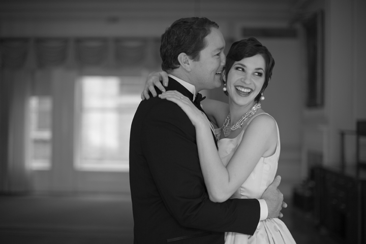 Black and white image of elegant laughing bride and groom