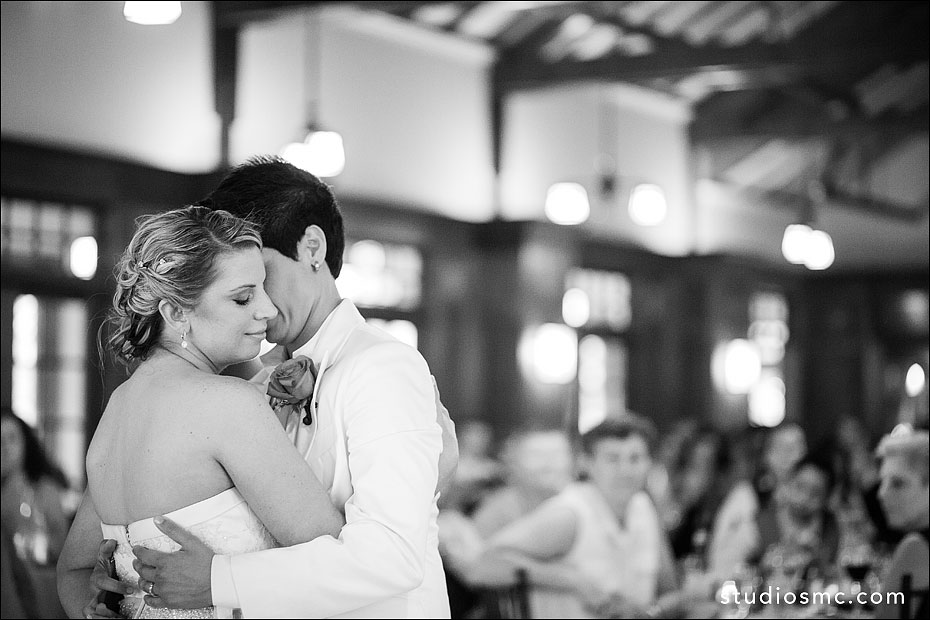 Two brides have a moment on the dancefloor