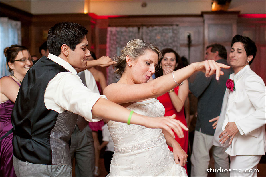 bride dancing with the best man at her wedding