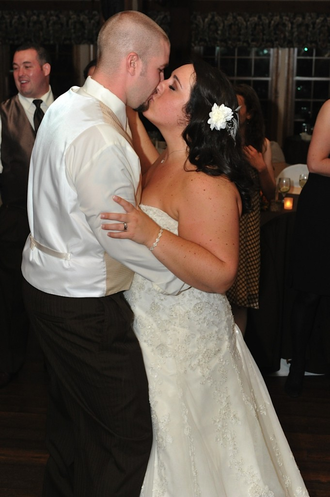 bride & groom kiss on the dancefloor
