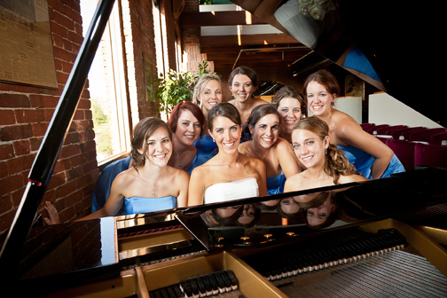 Bride & her bridesmaid posed with a piano