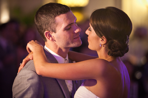 Elegant bride & groom share a moment on the dancefloor