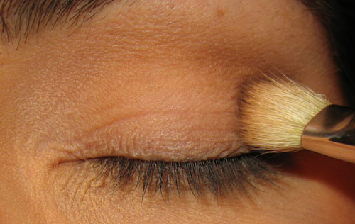 applying eyeshadow to the outer crease
