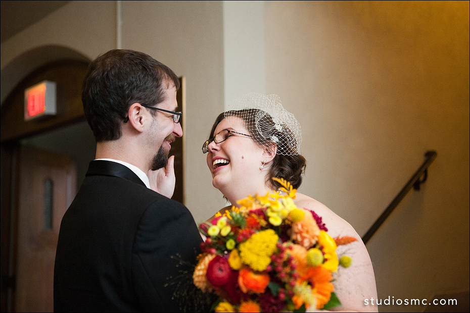 Bride and groom laughing together after ceremony